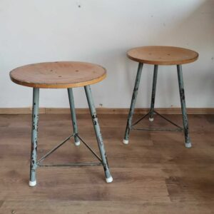 Set of 2 vintage factory stools with steel legs and hard ply top.